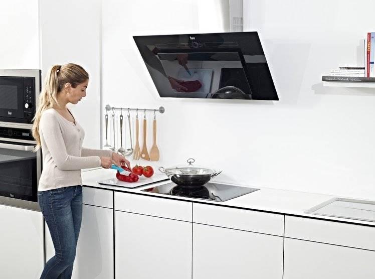 Стильные каминные вытяжки для кухни 60 см от известных брендов: выбираем оптимальную модель