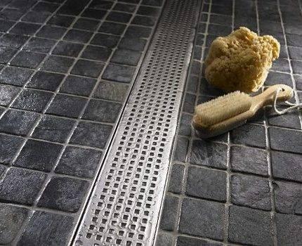Слив в полу в душе: основные преимущества и недостатки упрощенного способа канализации стоков