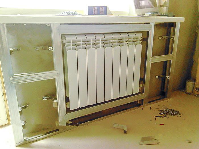Как закрыть батареи отопления и трубы гипсокартоном
