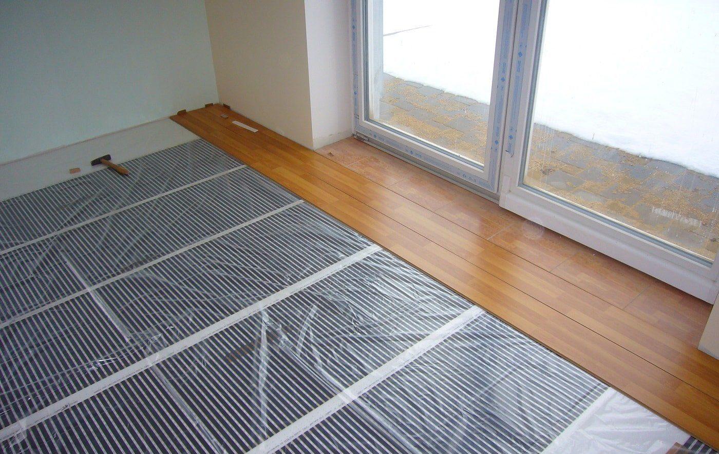 Как укладывать ламинат на теплый пол?