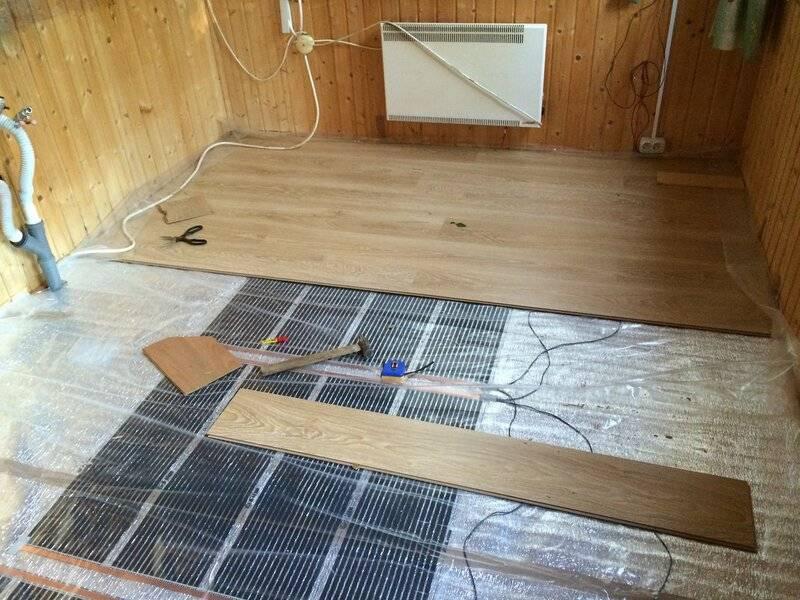 Теплый пол под ламинат на деревянный пол — инструкции по монтажу