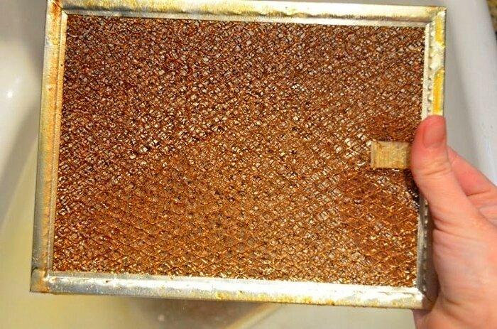Как очистить фильтр вытяжки от жира в домашних условиях: рекомендации