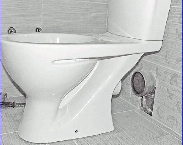 Унитаз с вертикальным выпуском в пол
