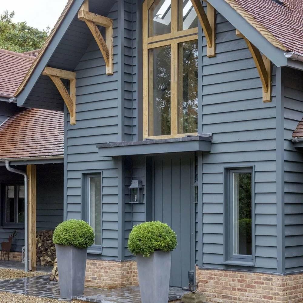 Чем обшить деревянный дом снаружи красиво и недорого: материалы, технологии, фото