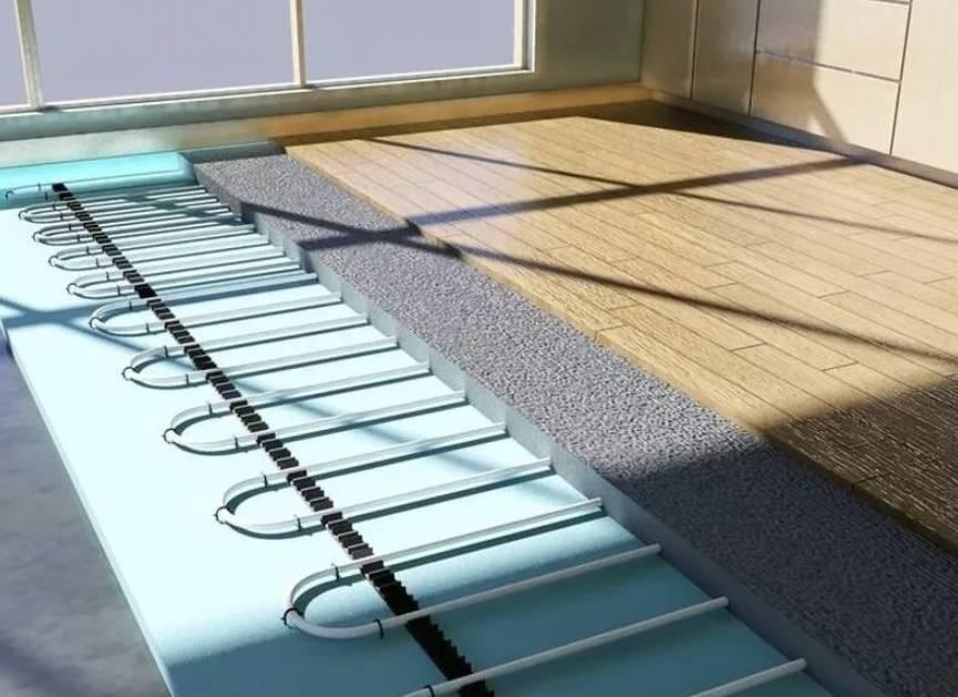 Теплый пол под ламинат: можно ли класть водяной вариант пола с подогревом под это покрытие, какие виды лучше подходят для укладки, установка и монтаж, отзывы специалистов