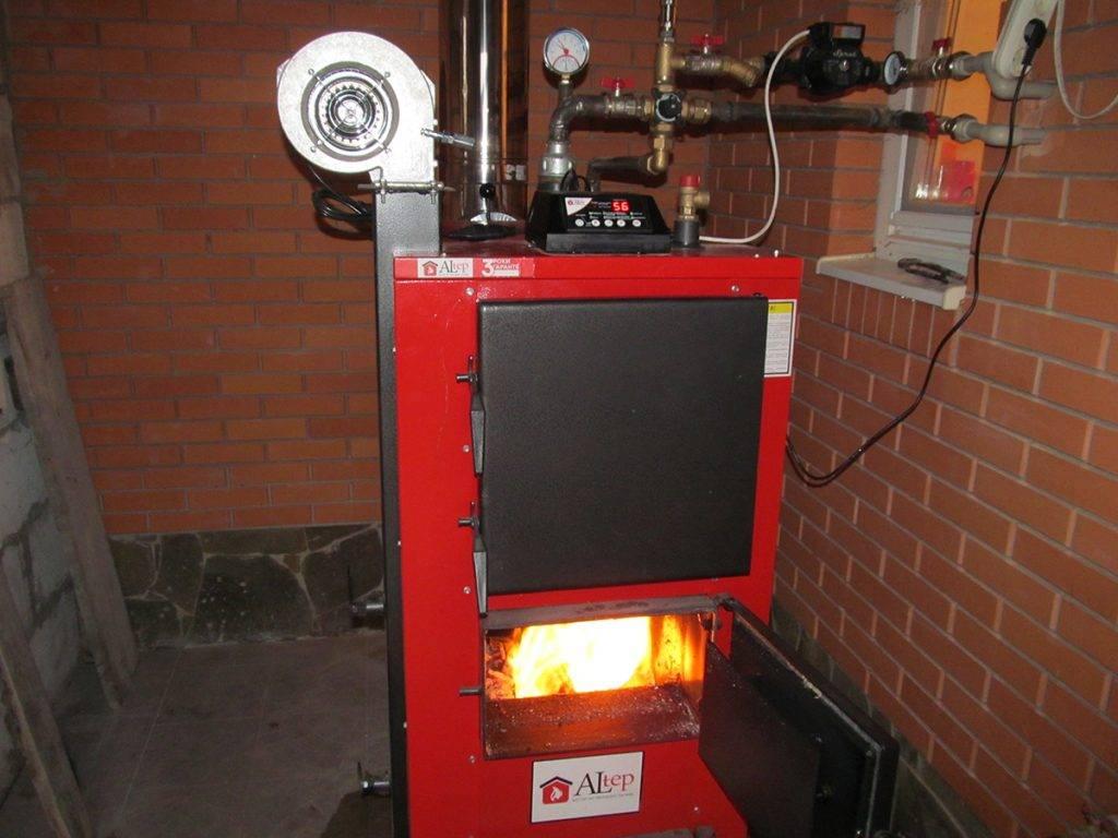 Твердотопливный котел (126 фото): варианты для отопления частного дома на твердом топливе, отопительные модели длительного горения