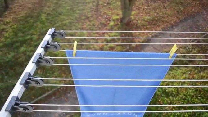 Сушилка для белья на балкон: фото, видео, виды, способы установки и типы конструкций